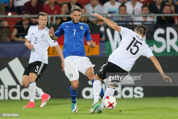 Yannick Gerhardt Domenico Berardi MarcOliver Kempf during the UEFA U21 European Championship Group C football match Italy v Germany in Krakow Poland...