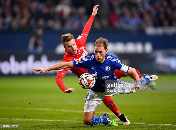 Yannick Gerhardt of 1 FC Koeln and Benedikt Hoewedes of FC Schalke 04 battle for the ball during the Bundesliga match between FC Schalke 04 and 1 FC...