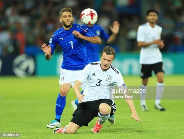 Yannick Gerhardt of Germany and Domenico Berardi of Italy battle for the ball during the 2017 UEFA European Under21 Championship Group C match...