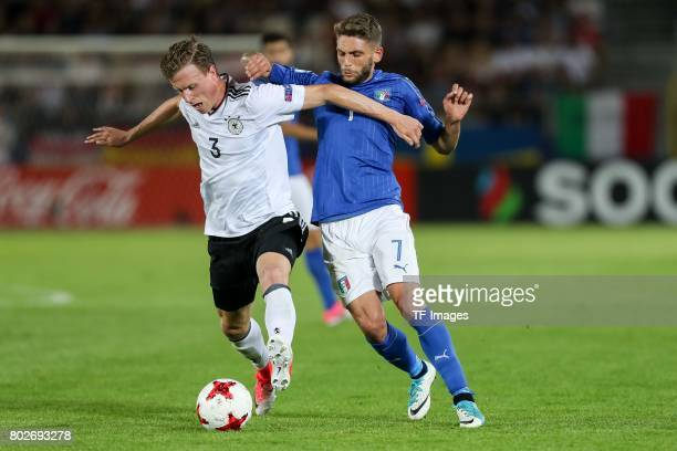 Yannick Gerhardt of Germany and Domenico Berardi of Italy battle for the ball during the UEFA U21 championship match between Italy and Germany at...