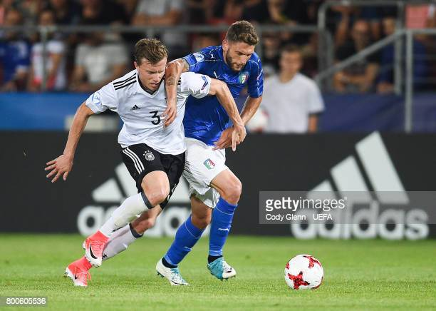 Yannick Gerhardt of Germany and Domenico Berardi of Italy during their UEFA European Under21 Championship 2017 match on June 24 2017 in Krakow Poland