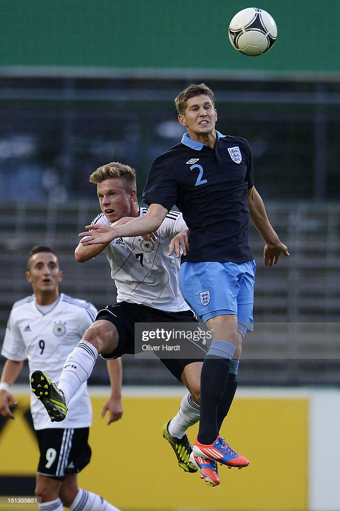 Yannick Gerhardt (L) of Germany and John Stones (R) of England battle for the ball during the Under 19 international friendly match between Germany and England at Stadion an der Lohmuehle on September 6, 2012 in Luebeck, Germany.