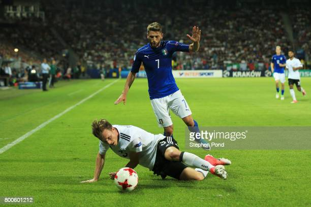 Yannick Gerhardt of Germany battles with Domenico Berardi of Italy during the 2017 UEFA European Under21 Championship Group C match between Italy and...