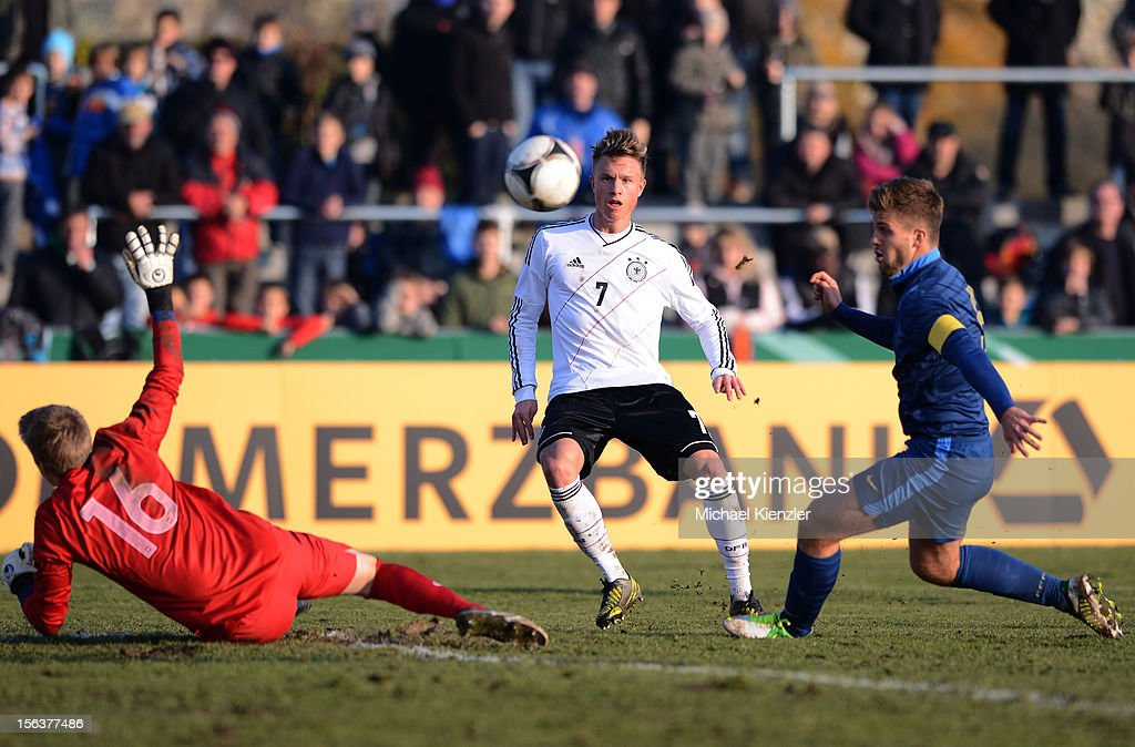 Yannick Gerhardt (middle) of Germany competes against Paul Nardi (l) and Lucas Rogeaux during the International Friendly match between U19 Germany and U19 France at Rheinstadium on November 14, 2012 in Kehl, Germany.