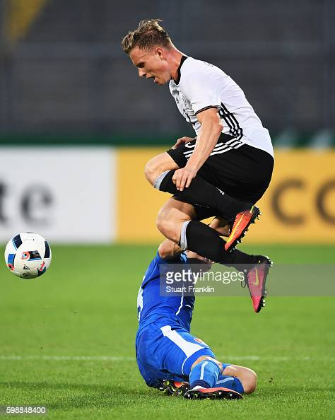 Yannick Gerhardt of Germany is challenged by Nicolas Spalek of Slovakia during the Under21 friendly match between U21 Germany and U21 Slovakia at...