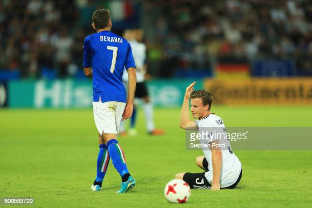 Yannick Gerhardt of Germany reacts towards Domenico Berardi of Italy during the 2017 UEFA European Under21 Championship Group C match between Italy...