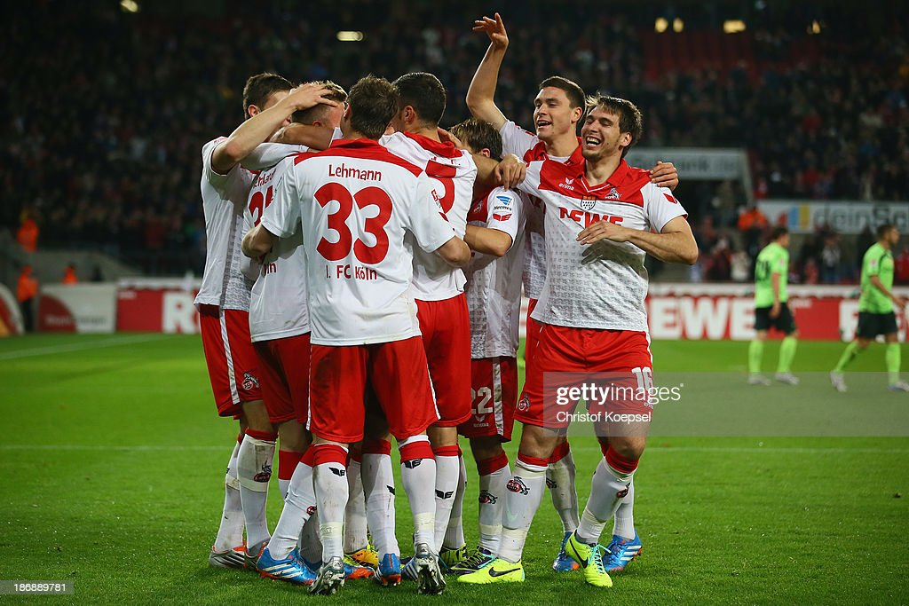 Yannick Gerhardt of Koeln (hidden) celebrates the third goal with his team mates during the Second Bundesliga match between 1. FC Koeln and 1. FC Union Berlin at RheinEnergieStadion on November 4, 2013 in Cologne, Germany.