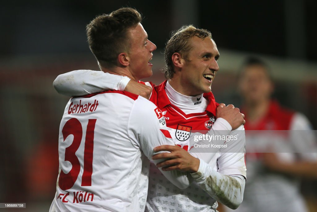 Yannick Gerhardt of Koeln celebrates the third goal with <a gi-track='captionPersonalityLinkClicked' href=/galleries/search?phrase=Marcel+Risse&family=editorial&specificpeople=4331527 ng-click='$event.stopPropagation()'>Marcel Risse</a> during the Second Bundesliga match between 1. FC Koeln and 1. FC Union Berlin at RheinEnergieStadion on November 4, 2013 in Cologne, Germany.