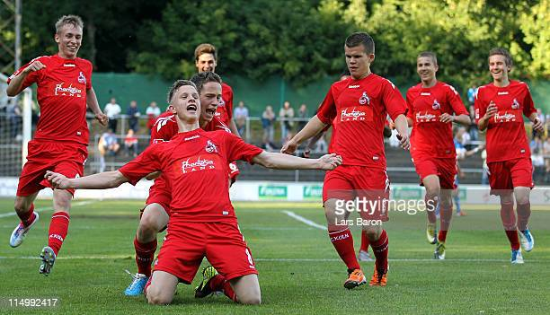 Yannick Gerhardt of Koeln celebrates with team mates after scoring his teams second goal during the BJunior Bundesliga semi final match between 1 FC...