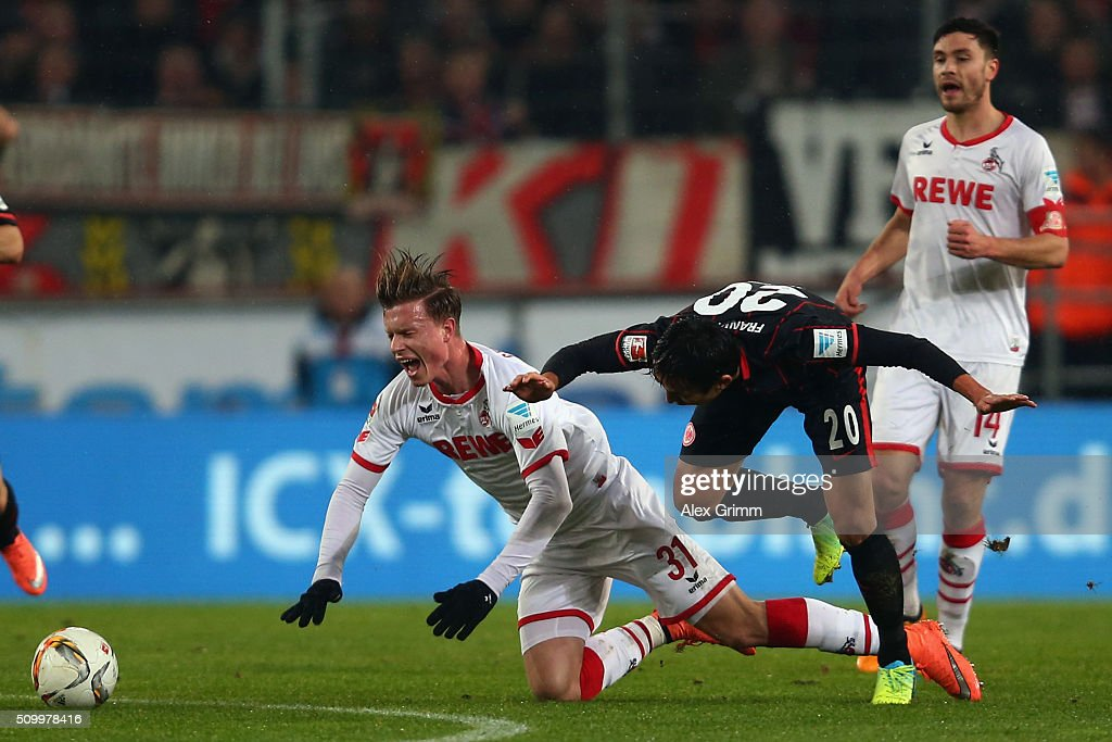 Yannick Gerhardt (L) of Koeln is challenged by <a gi-track='captionPersonalityLinkClicked' href=/galleries/search?phrase=Makoto+Hasebe&family=editorial&specificpeople=876998 ng-click='$event.stopPropagation()'>Makoto Hasebe</a> of Frankfurt during the Bundesliga match between 1. FC Koeln and Eintracht Frankfurt at RheinEnergieStadion on February 13, 2016 in Cologne, Germany.