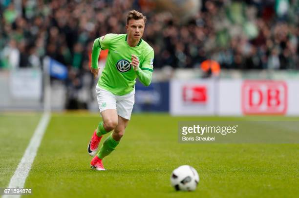 Yannick Gerhardt of VfL Wolfsburg runs with the ball during the Bundesliga match between Hertha BSC and VfL Wolfsburg at Olympiastadion on April 22...