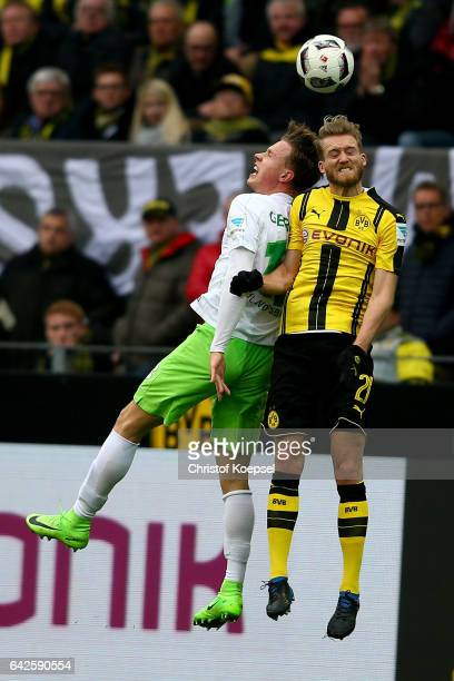 Yannick Gerhardt of Wolfsburg and Andre Schuerrle of Dortmund go up for a header during the Bundesliga match between Borussia Dortmund and VfL...