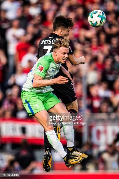 Yannick Gerhardt of Wolfsburg and Panagiotis Retsos of Leverkusen head the ball during the Bundesliga match between Bayer 04 Leverkusen and VfL...