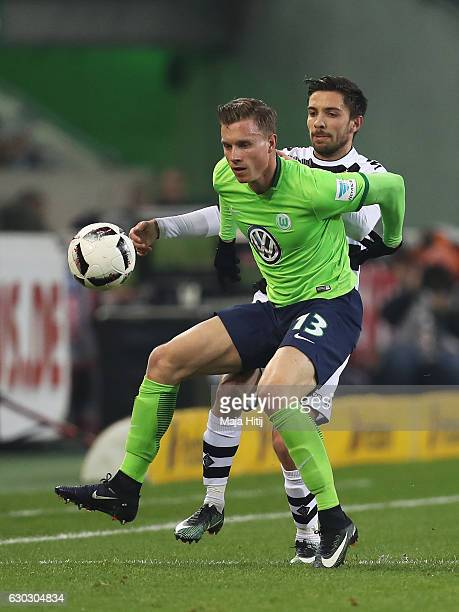 Yannick Gerhardt of Wolfsburg is closed down by Julian Korb of Borussia Moenchengladbach during the Bundesliga match between Borussia...