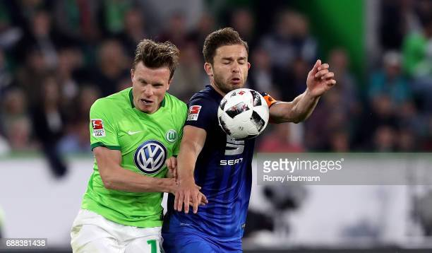 Yannick Gerhardt of Wolfsburg vies with Ken Reichel of Braunschweig during the Bundesliga Playoff first leg match between VfL Wolfsburg and Eintracht...