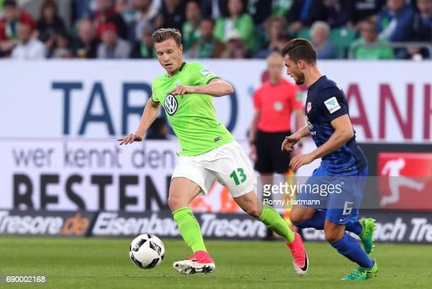 Yannick Gerhardt of Wolfsburg vies with Quirin Moll of Braunschweig during the Bundesliga Playoff first leg match between VfL Wolfsburg and Eintracht...