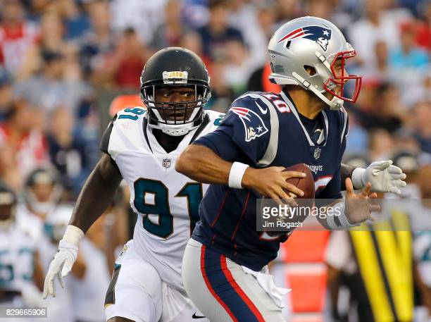 Yannick Ngakoue of the Jacksonville Jaguars chases Jimmy Garoppolo of the New England Patriots in the first half during a preseason game with New...