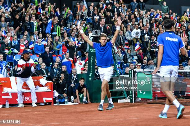 Yannick Noah coach of France Pierre Hugues Herbert and Nicolas Mahut of France celebrates the victory during the day 2 of the Semifinals of the Davis...