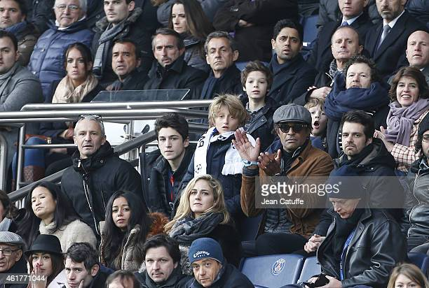 Yannick Noah his son Joalukas Noah above them Jade Lagardere Arnaud Lagardere director of PSG JeanClaude Blanc former French President Nicolas...