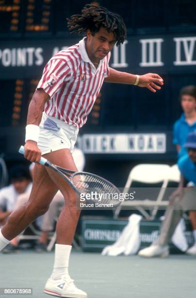 Yannick Noah of France hits the backhand during a match against Andre Agassi in the Norstar Hamlet Challenge Cup on August 28 1988 in Jericho New York