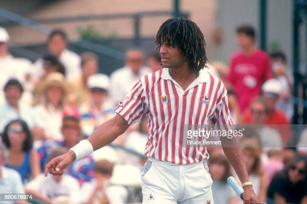Yannick Noah of France points during a match against Andre Agassi in the Norstar Hamlet Challenge Cup on August 28 1988 in Jericho New York
