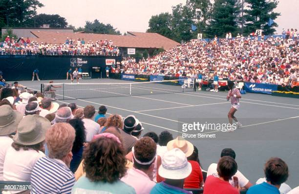 Yannick Noah of France returns the backhand during a match against Andre Agassi in the Norstar Hamlet Challenge Cup on August 28 1988 in Jericho New...