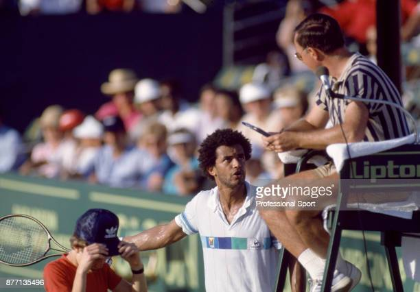 Yannick Noah of France speaks to the umpire during the Lipton International Players Championships at the Tennis Center at Crandon Park in Key...