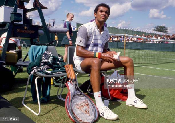 Yannick Noah of France takes a break during his first round match against Brad Gilbert of the USA in the Wimbledon Lawn Tennis Championships at the...