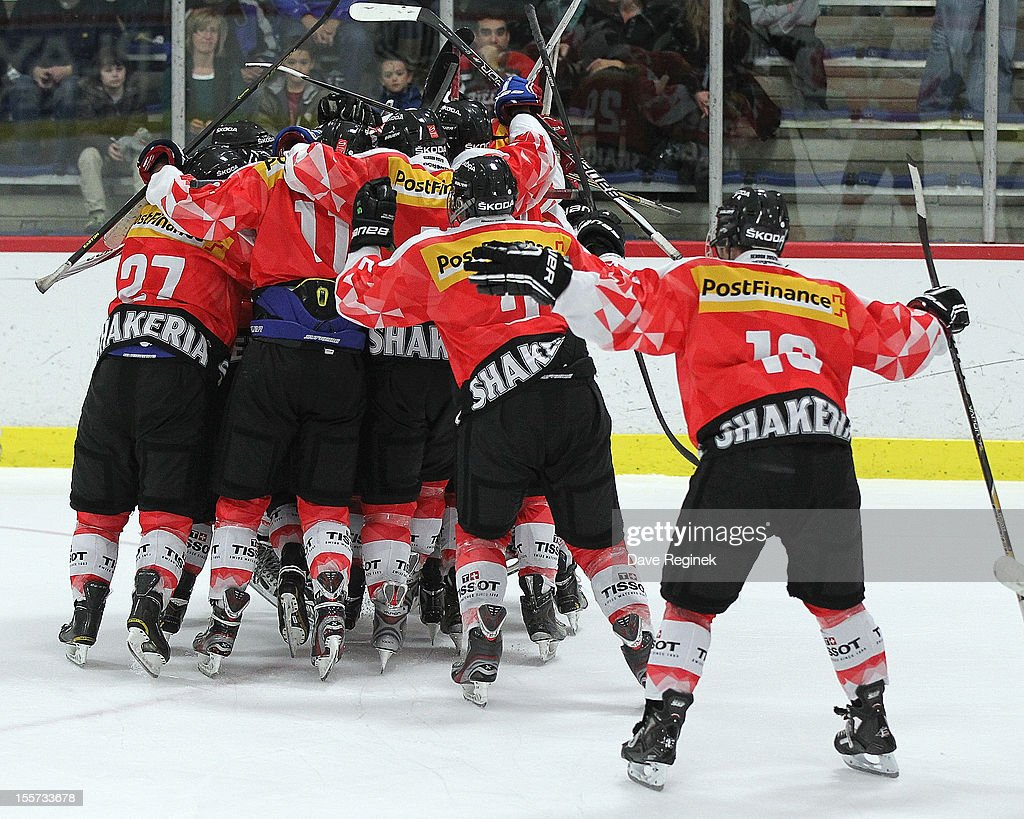 Yannick Rathgeb #29 of team Switzerland celebrates his game winning shoot-out goal with teammates against team USA during game two of the U-18 Four Nations Cup on November 7, 2012 at the Ice Cube arena in Ann Arbor, Michigan.