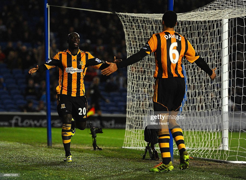 <a gi-track='captionPersonalityLinkClicked' href=/galleries/search?phrase=Yannick+Sagbo&family=editorial&specificpeople=6130628 ng-click='$event.stopPropagation()'>Yannick Sagbo</a> of Hull City celebrates scoring their first goal with <a gi-track='captionPersonalityLinkClicked' href=/galleries/search?phrase=Curtis+Davies&family=editorial&specificpeople=647039 ng-click='$event.stopPropagation()'>Curtis Davies</a> of Hull City during the FA Cup fifth round match between Brighton & Hove Albion and Hull City at Amex Stadium on February 17, 2014 in Brighton, England.