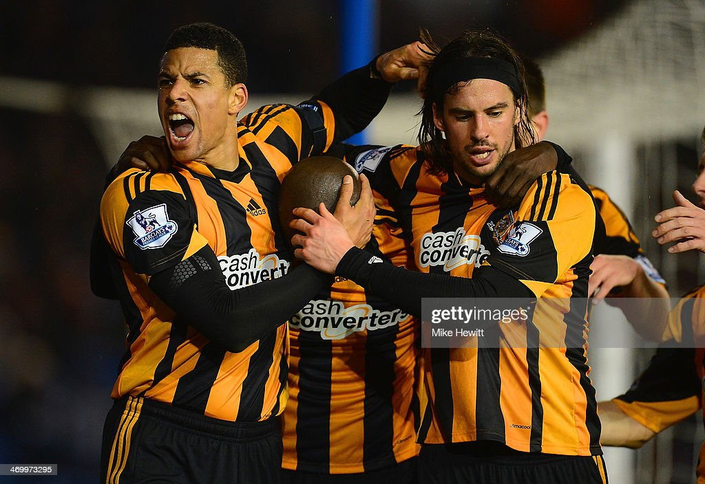 <a gi-track='captionPersonalityLinkClicked' href=/galleries/search?phrase=Yannick+Sagbo&family=editorial&specificpeople=6130628 ng-click='$event.stopPropagation()'>Yannick Sagbo</a> of Hull City celebrates scoring their first goal with <a gi-track='captionPersonalityLinkClicked' href=/galleries/search?phrase=Curtis+Davies&family=editorial&specificpeople=647039 ng-click='$event.stopPropagation()'>Curtis Davies</a> and George Boyd of Hull City during the FA Cup fifth round match between Brighton & Hove Albion and Hull City at Amex Stadium on February 17, 2014 in Brighton, England.