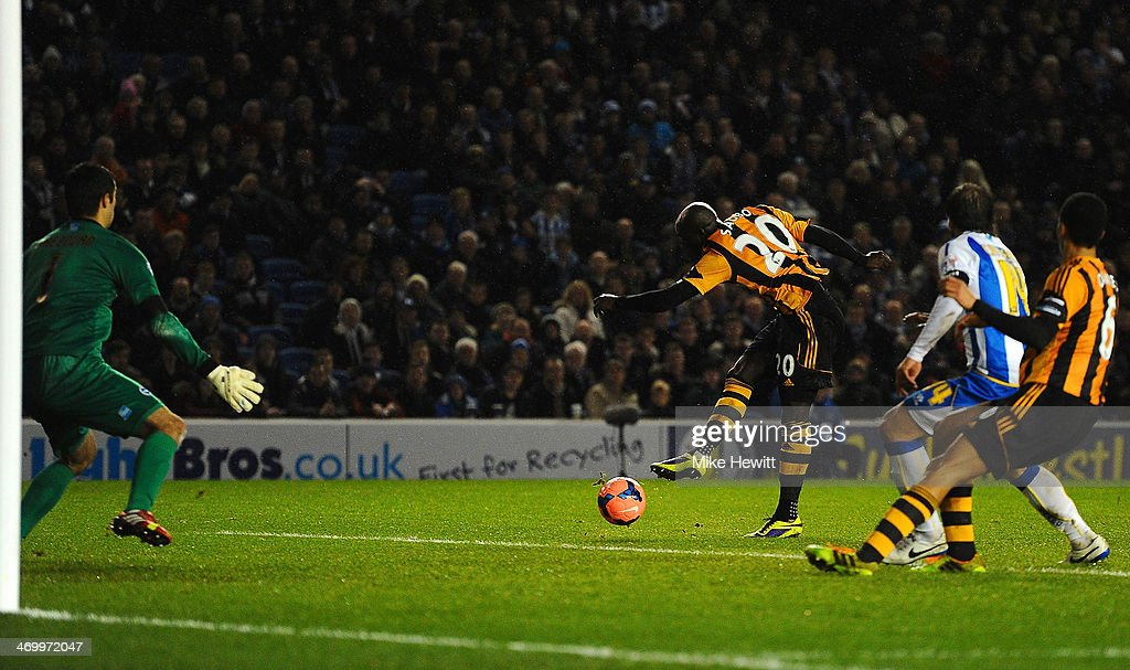 <a gi-track='captionPersonalityLinkClicked' href=/galleries/search?phrase=Yannick+Sagbo&family=editorial&specificpeople=6130628 ng-click='$event.stopPropagation()'>Yannick Sagbo</a> of Hull City scores their first goal during the FA Cup fifth round match between Brighton & Hove Albion and Hull City at Amex Stadium on February 17, 2014 in Brighton, England.