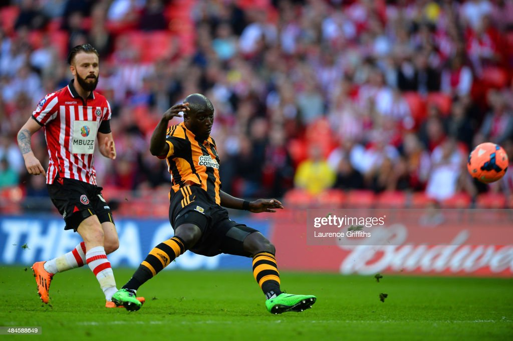 <a gi-track='captionPersonalityLinkClicked' href=/galleries/search?phrase=Yannick+Sagbo&family=editorial&specificpeople=6130628 ng-click='$event.stopPropagation()'>Yannick Sagbo</a> of Hull City scores their first goal during the FA Cup with Budweiser semi-final match between Hull City and Sheffield United at Wembley Stadium on April 13, 2014 in London, England.