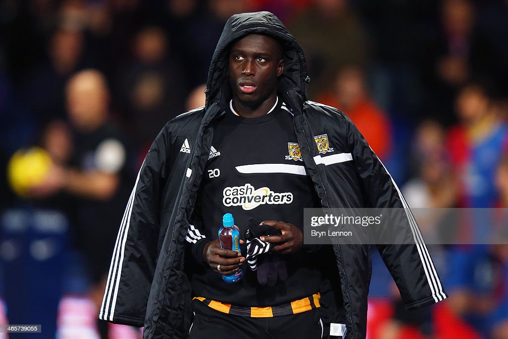 <a gi-track='captionPersonalityLinkClicked' href=/galleries/search?phrase=Yannick+Sagbo&family=editorial&specificpeople=6130628 ng-click='$event.stopPropagation()'>Yannick Sagbo</a> of Hull City walks onto the pitch for the Barclays Premier League match between Crystal Palace v Hull City at Selhurst Park on January 28, 2014 in London, England.