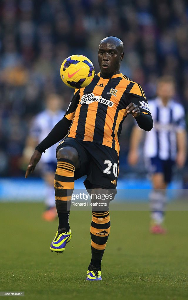 <a gi-track='captionPersonalityLinkClicked' href=/galleries/search?phrase=Yannick+Sagbo&family=editorial&specificpeople=6130628 ng-click='$event.stopPropagation()'>Yannick Sagbo</a> of Hull in action during the Barclays Premier League match between West Bromwich Albion and Hull City at The Hawthorns on December 21, 2013 in West Bromwich, England.