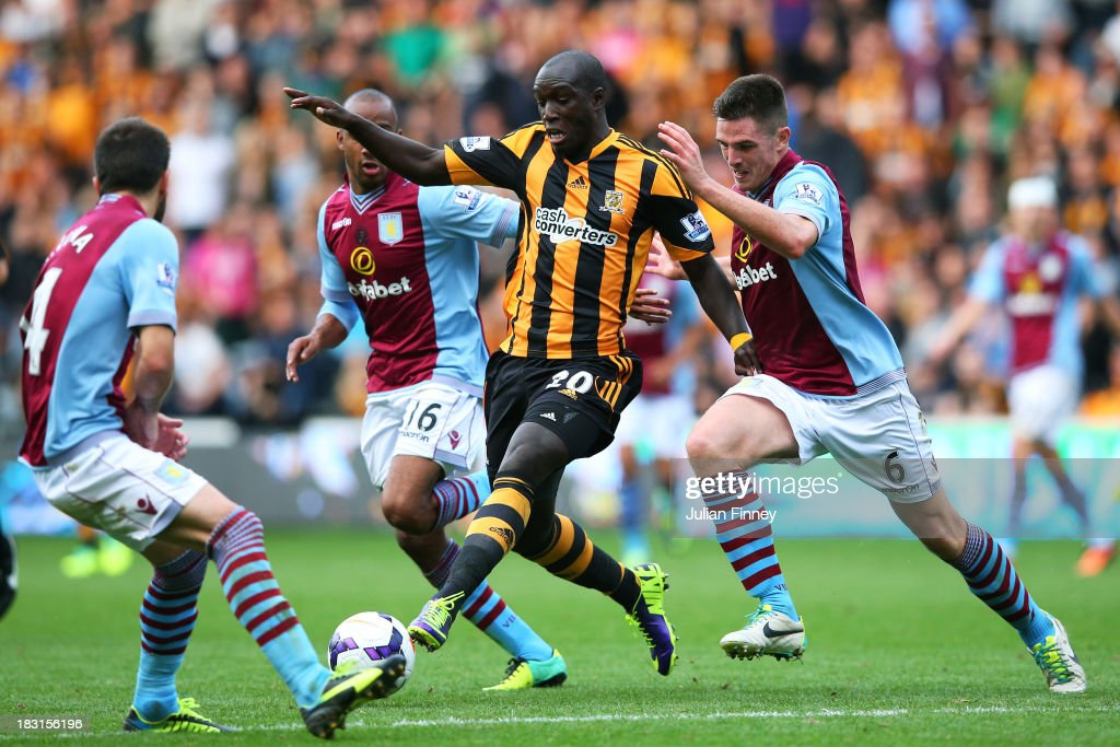 <a gi-track='captionPersonalityLinkClicked' href=/galleries/search?phrase=Yannick+Sagbo&family=editorial&specificpeople=6130628 ng-click='$event.stopPropagation()'>Yannick Sagbo</a> of Hull is tackled by <a gi-track='captionPersonalityLinkClicked' href=/galleries/search?phrase=Ron+Vlaar&family=editorial&specificpeople=605352 ng-click='$event.stopPropagation()'>Ron Vlaar</a> (L) and <a gi-track='captionPersonalityLinkClicked' href=/galleries/search?phrase=Ciaran+Clark&family=editorial&specificpeople=4644641 ng-click='$event.stopPropagation()'>Ciaran Clark</a> (R) of Aston Villa during the Barclays Premier League match between Hull City and Aston Villa at KC Stadium on October 5, 2013 in Hull, England.