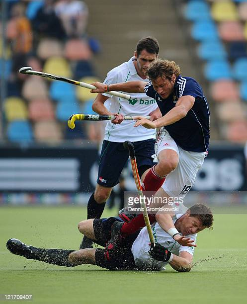 Yannick Schambert of France is challenged by Joseph Brennan of Ireland during the Men´s EuroHockey Championships 2011 Pool B match between France and...
