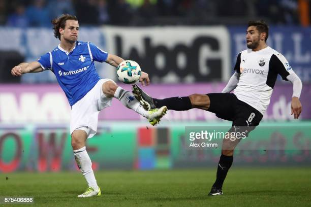Yannick Stark of Darmstadt is challenged by Nejmeddin Daghfous of Sandhausen during the Second Bundesliga match between SV Darmstadt 98 and SV...