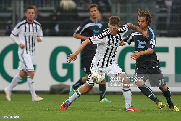 Yannick Stark of Muenchen challenges Manuel Junglas of Aalen during the Second Bundesliga match between VfR Aalen and 1860 Muenche at ScholzArena on...