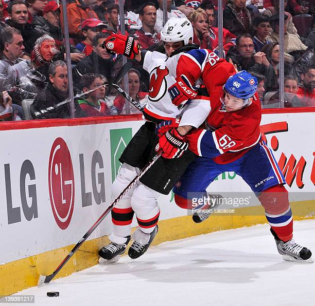 Yannick Weber of the Montreal Canadiens battles for the puck with Nick Palmieri of the New Jersey Devils during the NHL game on February 19 2012 at...