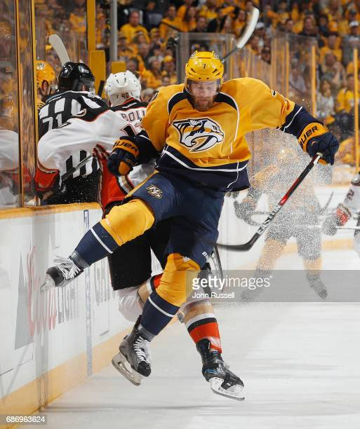 Yannick Weber of the Nashville Predators avoid a check from Jared Boll of the Anaheim Ducks in Game Six of the Western Conference Final during the...