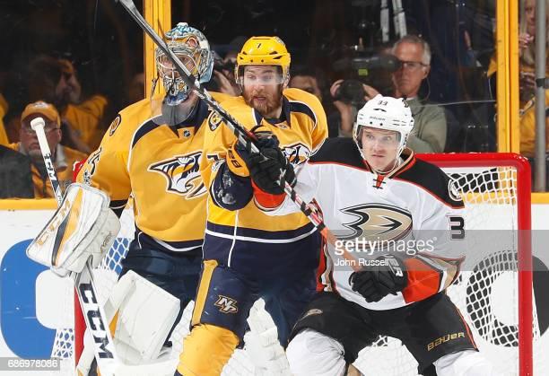 Yannick Weber of the Nashville Predators battles against Jakob Silfverberg of the Anaheim Ducks in front of goalie Pekka Rinne in Game Six of the...