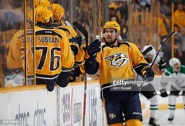 Yannick Weber of the Nashville Predators celebrates a goal with the bench against the Dallas Stars during an NHL game at Bridgestone Arena on...