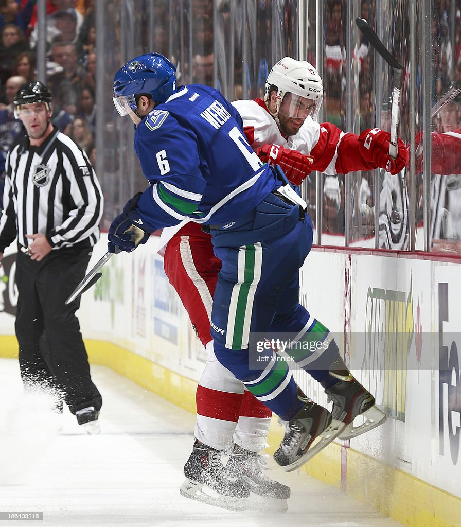 <a gi-track='captionPersonalityLinkClicked' href=/galleries/search?phrase=Yannick+Weber&family=editorial&specificpeople=4324944 ng-click='$event.stopPropagation()'>Yannick Weber</a> #6 of the Vancouver Canucks checks <a gi-track='captionPersonalityLinkClicked' href=/galleries/search?phrase=Patrick+Eaves&family=editorial&specificpeople=616319 ng-click='$event.stopPropagation()'>Patrick Eaves</a> #17 of the Detroit Red Wings during their NHL game at Rogers Arena on October 30, 2013 in Vancouver, British Columbia, Canada. Detroit won 2-1.