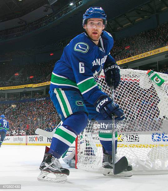 Yannick Weber of the Vancouver Canucks looks for the puck during Game Two of the Western Conference Quarterfinals against the Calgary Flames during...
