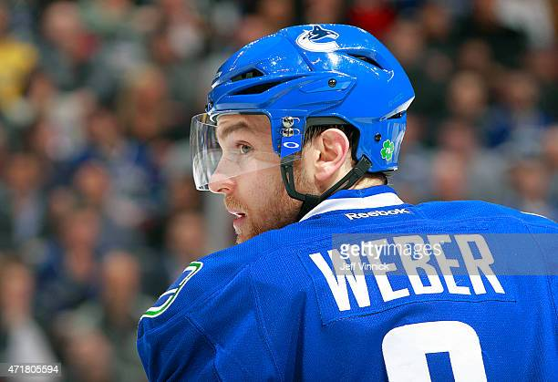 Yannick Weber of the Vancouver Canucks looks on from the bench during their NHL game against the Los Angeles Kings at Rogers Arena April 6 2015 in...