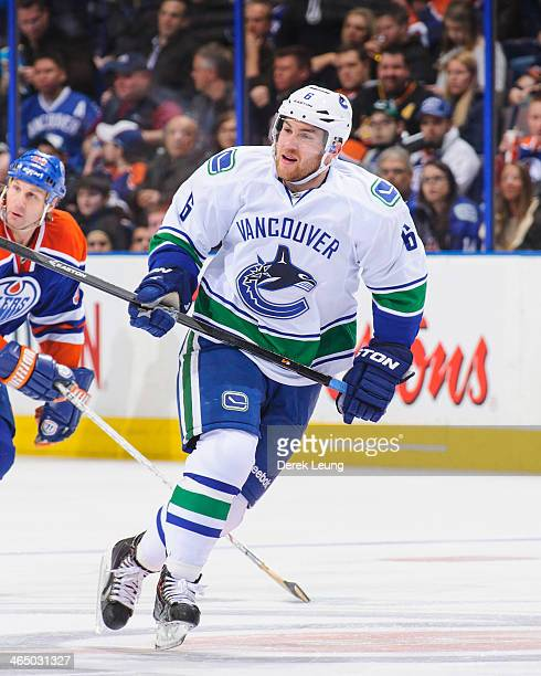 Yannick Weber of the Vancouver Canucks skates against the Edmonton Oilers during an NHL game at Rexall Place on January 21 2014 in Edmonton Alberta...