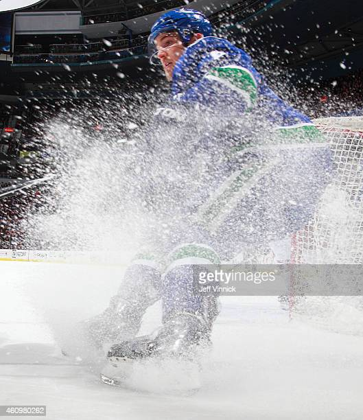 Yannick Weber of the Vancouver Canucks skates up ice during their NHL game against the Arizona Coyotes at Rogers Arena December 22 2014 in Vancouver...