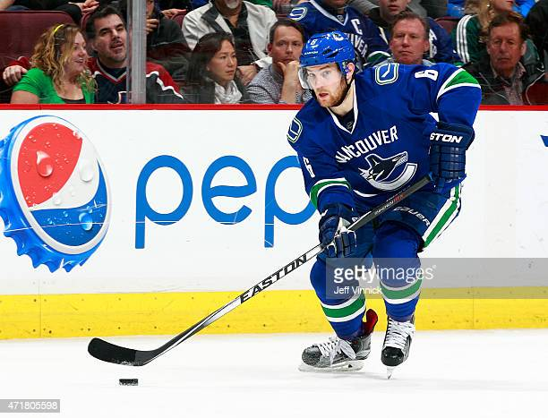 Yannick Weber of the Vancouver Canucks skates up ice with the puck during their NHL game against the Los Angeles Kings at Rogers Arena April 6 2015...