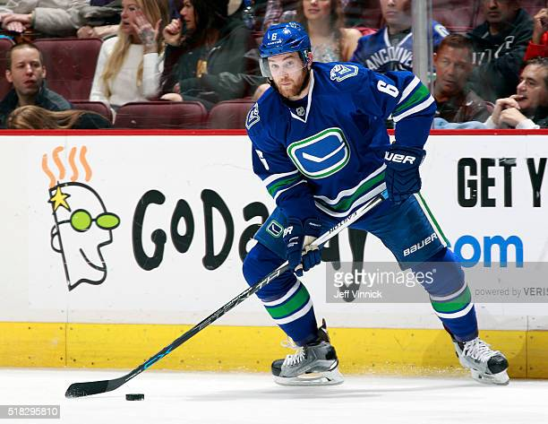 Yannick Weber of the Vancouver Canucks skates up ice with the puck during their NHL game against the Chicago Blackhawks at Rogers Arena March 27 2016...